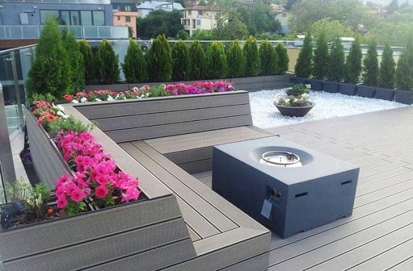 Декинг система върху подпори преобразява покривна тераса